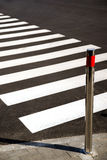 Crosswalk markings painted on asphalt in the city Stock Photo