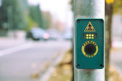 Crosswalk pedestrian button on street Royalty Free Stock Photography