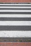 Crosswalk. A pedestrian crossing in a city street cradle Royalty Free Stock Photos