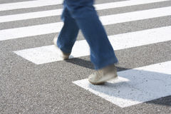 Crosswalk. A pedestrian while crossing the road at the pedestrian crossing Stock Photos