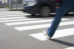 Crosswalk. A pedestrian while crossing the road at the pedestrian crossing Royalty Free Stock Photos