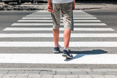Crosswalk. Pedestrian on road. Crosswalk. Pedestrian running on road Royalty Free Stock Photography