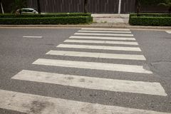 Old crosswalk on the road. A crosswalk for pedestrians crossing the street. A crosswalk for pedestrians crossing the street. Old crosswalk on the road stock images