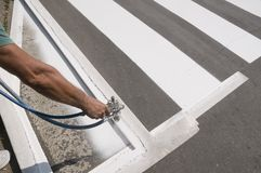 Crosswalk repairing Stock Photo