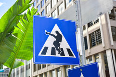 Crosswalk road sign with a guy Stock Photos