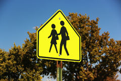 Crosswalk sign. A yellow crosswalk sign on a street Royalty Free Stock Photos