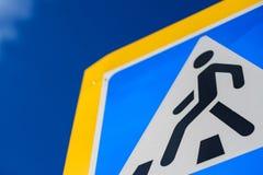 Crosswalk sign blue warning pedestrian. symbol royalty free stock photo