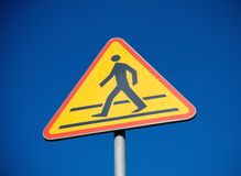 Crosswalk sign and clear blue sky Royalty Free Stock Photo