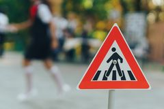 Crosswalk sign and kids bokeh royalty free stock photos