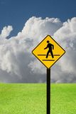 Crosswalk sign with a man walking on yellow Royalty Free Stock Image