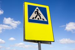 Crosswalk sign on sky background royalty free stock photography