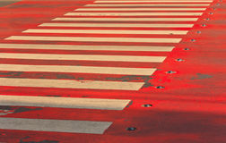 Crosswalk white on a red background Royalty Free Stock Photography