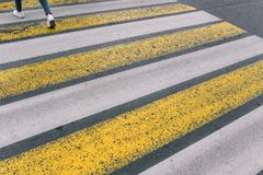 Crosswalk. White and yellow lines. Asphalt road. Security in the city. royalty free stock photos