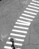 Crosswalk. Worker walking at a pedestrian crossing at the seaport royalty free stock photo