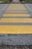 Crosswalk. The yellow crosswalk on the road royalty free stock image