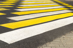 Crosswalk yellow-white warning bright color. Royalty Free Stock Photography