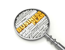 Crossword Business plan. Magnifying glass Stock Photography