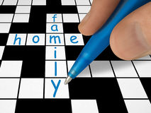 Crossword - family and home. Hand with pen stock photos
