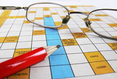 Crossword with a glasses Stock Images