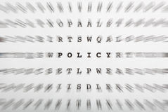 Crossword letters, focus on word policy Stock Images