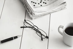 Crossword and pencil on wooden background Stock Images