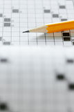 Crossword puzzle. Close up of pencil on crossword puzzle. Copy space Stock Images