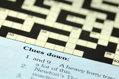 Crossword puzzle. Closeup with clues down Royalty Free Stock Photo