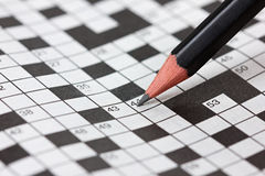 Crossword puzzle and black pencil Stock Photography