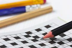 crossword puzzle and black pencils Stock Photos