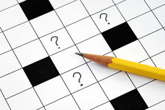 Crossword puzzle with many question marks Royalty Free Stock Image