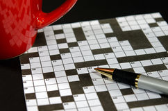 Crossword puzzle with red mug Stock Photo