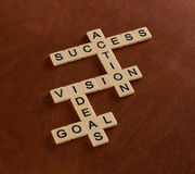 Crossword puzzle with words Goal, Ideas, Vision, Action, Success Stock Photo
