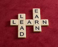 Crossword puzzle with words Learn, Lead and Earn. Leadership con Royalty Free Stock Images