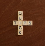 Crossword puzzle with words Quick Tips. Travel guide concept. Royalty Free Stock Image