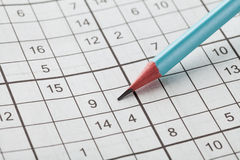 Crossword sudoku and blue pencil for entertainment Stock Images