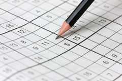 Crossword sudoku and pencil Royalty Free Stock Image