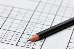 Crossword sudoku and pencil Royalty Free Stock Images