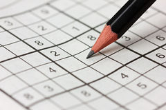 Crossword sudoku and pencil Stock Image