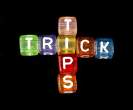 Crossword Tips and Tricks. Black isolated cubes Royalty Free Stock Photos
