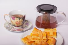 Crostata with apricot jam and a cup of tea. Royalty Free Stock Photography