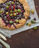 Crostata or galette pie with fresh garden berries Stock Image