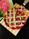 Crostata with plums and almond. Shortcrust pie with plums and almond. Italian cuisine dish royalty free stock photography