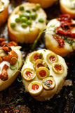 Crostini with addition of melted mozzarella cheese and green olives Royalty Free Stock Photography