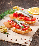 Crostini with anchovies Stock Images