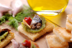 Crostini with anchovy. Crostini with asparagus cream and anchovies Stock Image