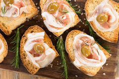 Crostini with bacon and olives, Italian Finger Food Stock Image