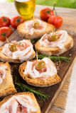 Crostini with bacon and olives, Italian Finger Food Royalty Free Stock Image