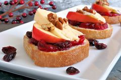 Crostini with cranberry sauce, apples, brie and pecans Royalty Free Stock Photos