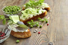 Crostini with cream cheese, green vegetables and herbs Royalty Free Stock Images