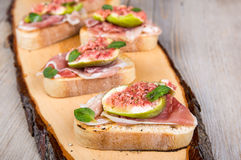 Crostini with fresh fig, peppermint and prosciutto ham Stock Images